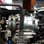компресор автокондиционера на трактор